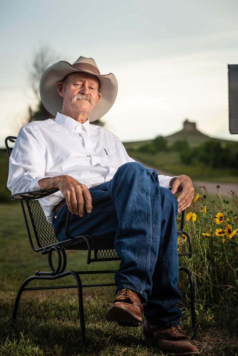 Ray Stokes sits for a portrait with his beloved Council Butte in the distance two months prior to his passing.
