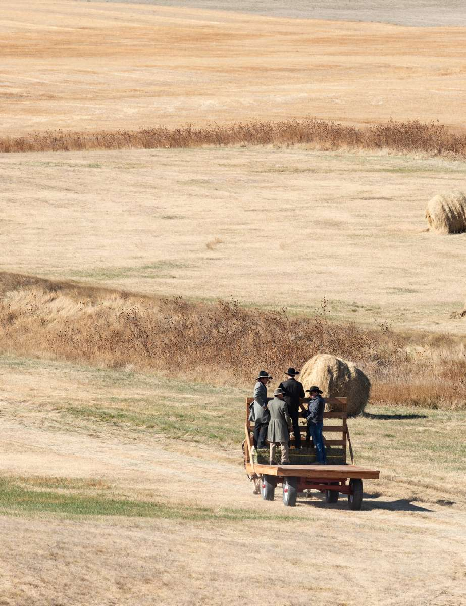 The horse drawn cart leaves the burial site.