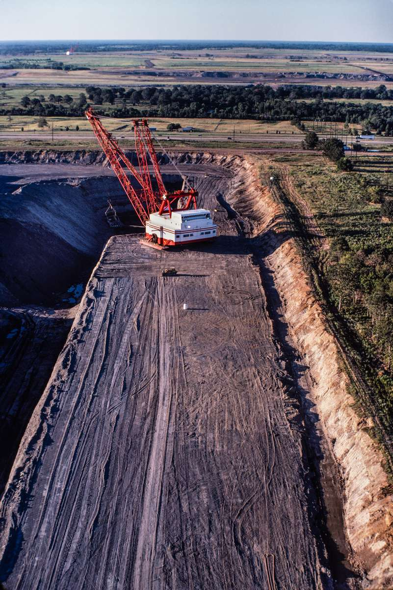 Aerial image of a Bucyrus Erie walking dragline excavating at the Winfield lignite coal strip mine near Interstate 30 and Mt. Pleasant, Texas. The mine and the Monticello Power Plant that it fed have now been closed.
