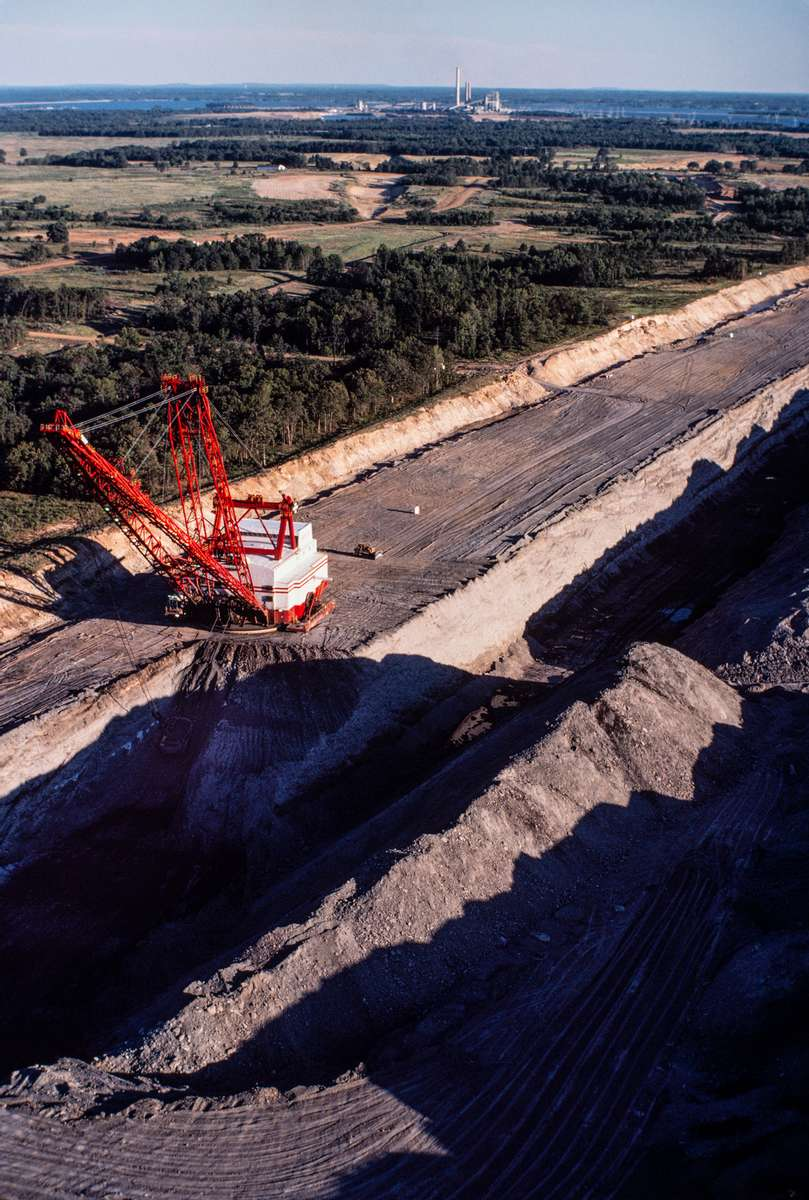 Aerial image of a Bucyrus Erie walking dragline excavating at the Winfield lignite coal strip mine near Interstate 30 and Mt. Pleasant, Texas. The mine and the Monticello Power Plant that it fed have now been closed. it fed have now been closed.