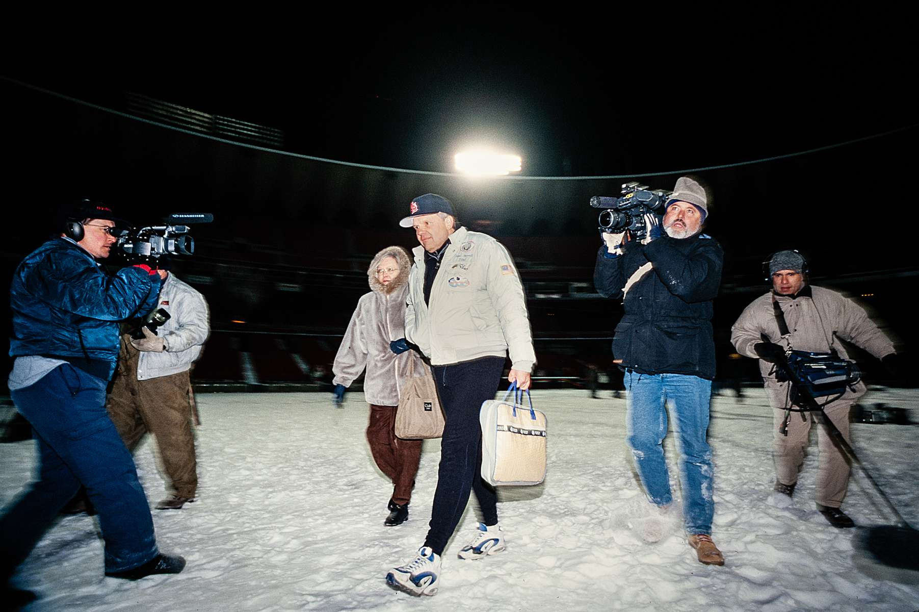 Media crews move quickly to get the images and sounds of Steve and Peggy Fossett in the St. Louis Busch Stadium as he heads to the Solo Spirit balloon for his second RTW (Round The World) solo flight attempt on January 13, 1997.