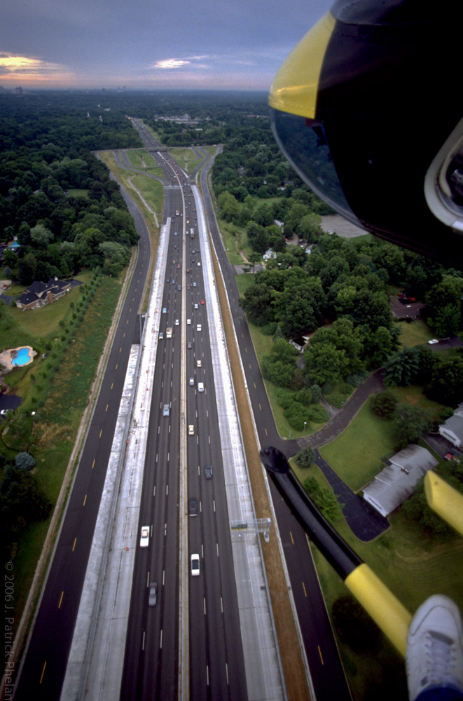 This vertical birds-eye view of I-64 looking east towards downtown St. Louis prior to it's expansion in the Frontenac, Missouri area. The expansion project is complete now and greatly improves drive times from the western suburbs to Clayton and downtown St. Louis.