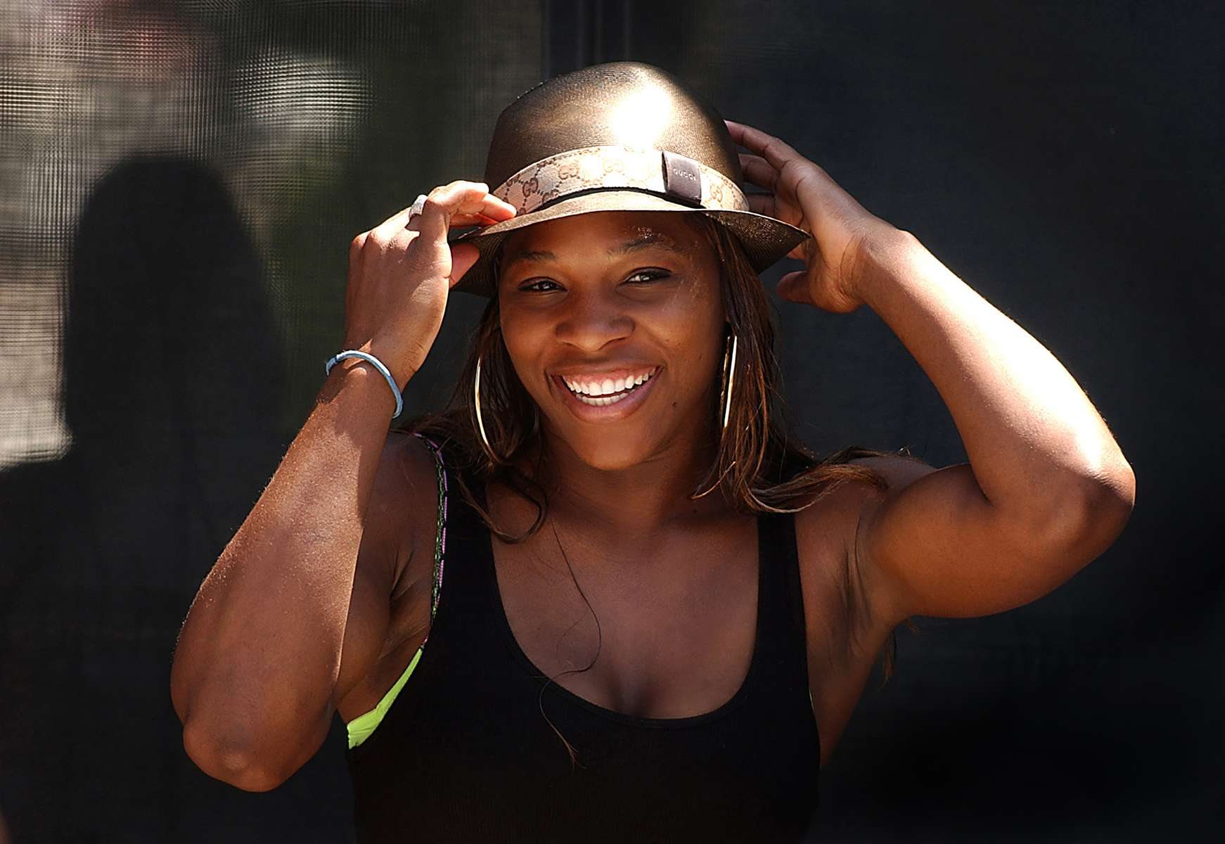 4/16/2004: Serena Williams didn't play tennis Friday, but she was on hand to donate some money to charity and to cheer for his sister Venus at the Family Circle Cup in Charleston. CHRISTOPHER A. RECORD - STAFF PHOTO