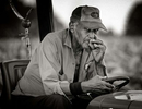 (7/29/97 STANCILL)Les Mix, 76, who has labored on tobacco farms most of his life, takes a smoke break. CHRISTOPHER A. RECORD/Staff