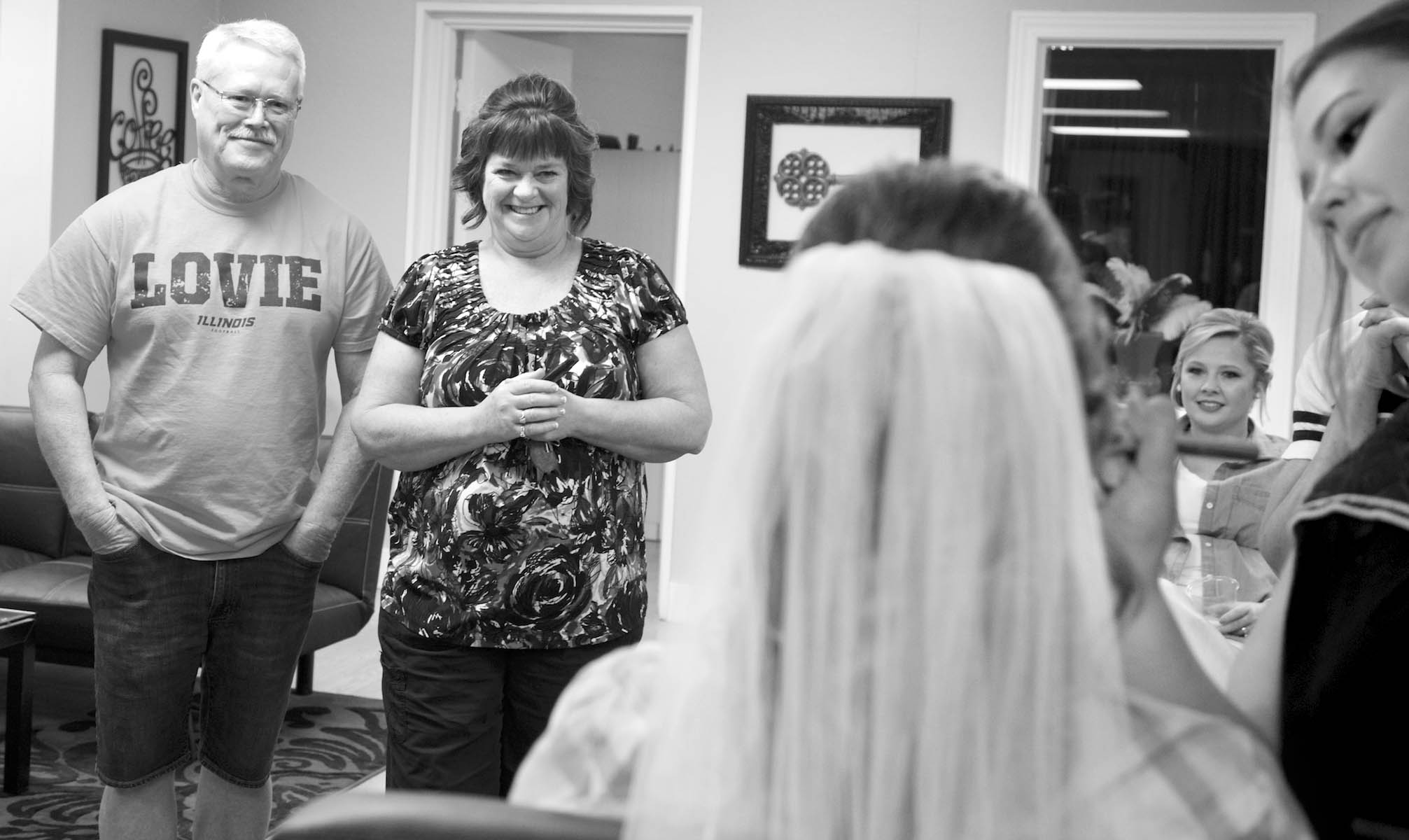 Alissa's mom and dad watch her get makeup done, at On the Clip Side. Wedding pictures by Tiffany & Steve of Warmowski Photography.