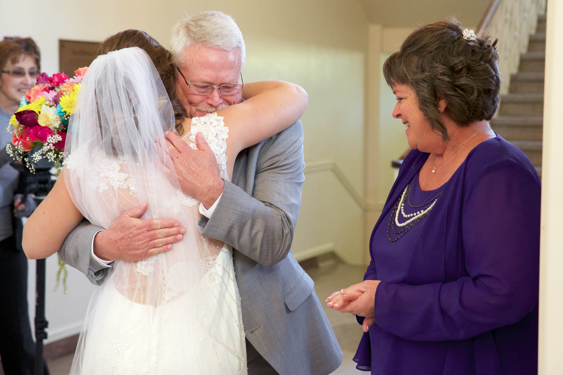 John hugs Alissa after seeing her in her wedding dress. Wedding pictures by Tiffany & Steve of Warmowski Photography.