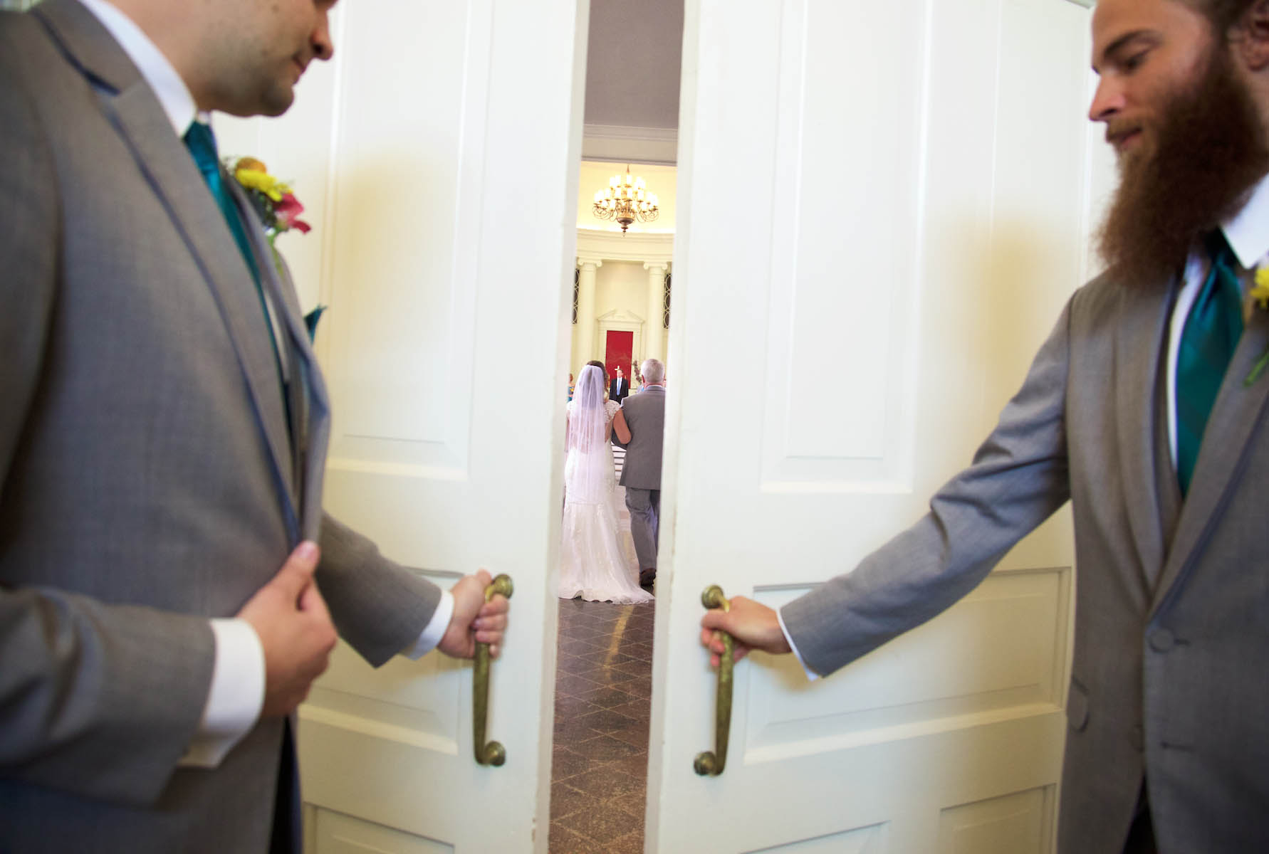 The ushers close the rear doors as Alissa and her father walk to the altar. Wedding pictures by Tiffany & Steve of Warmowski Photography.