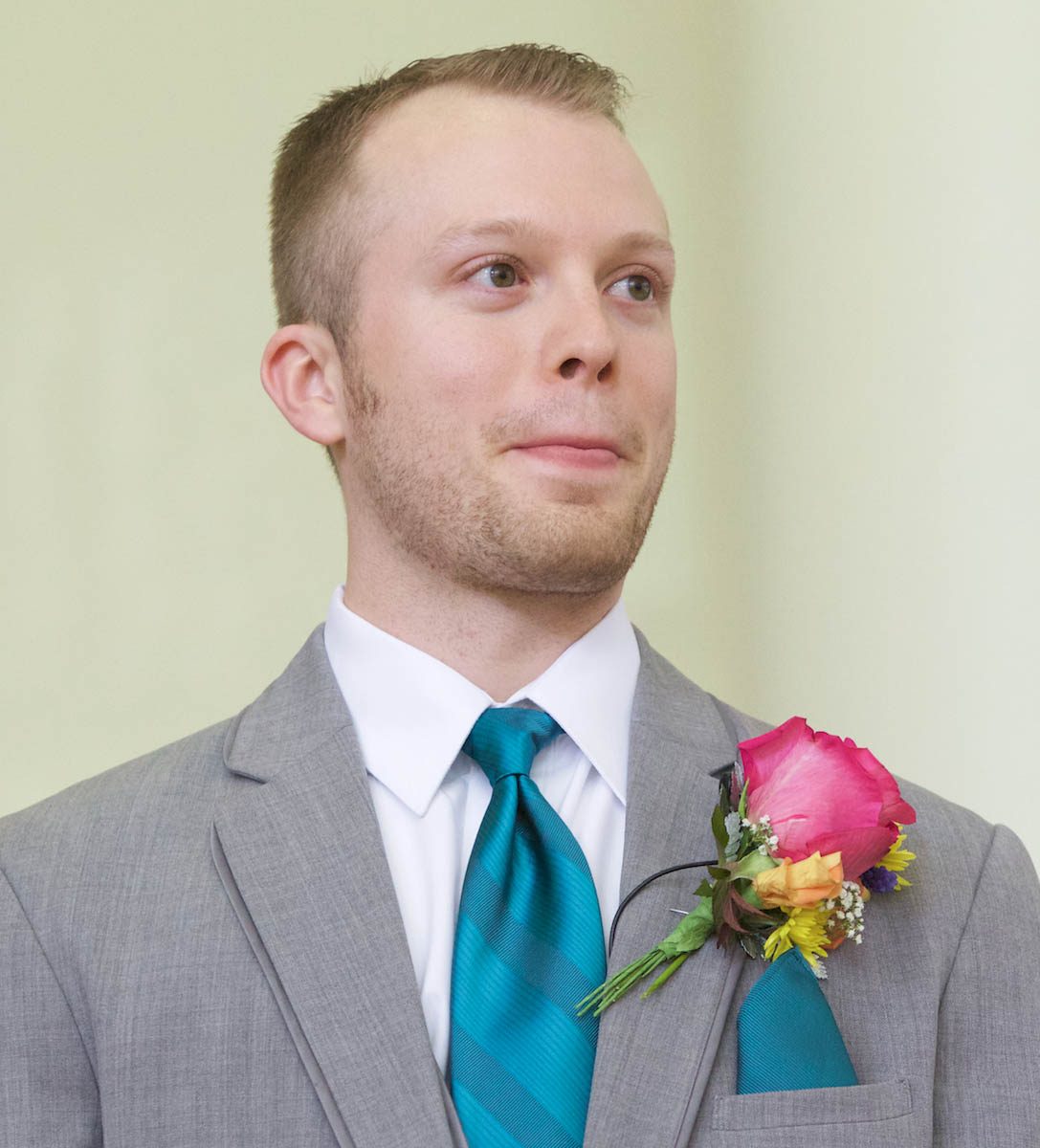 Ben reacts as Alissa walks down the aisle. Wedding pictures by Tiffany & Steve of Warmowski Photography.