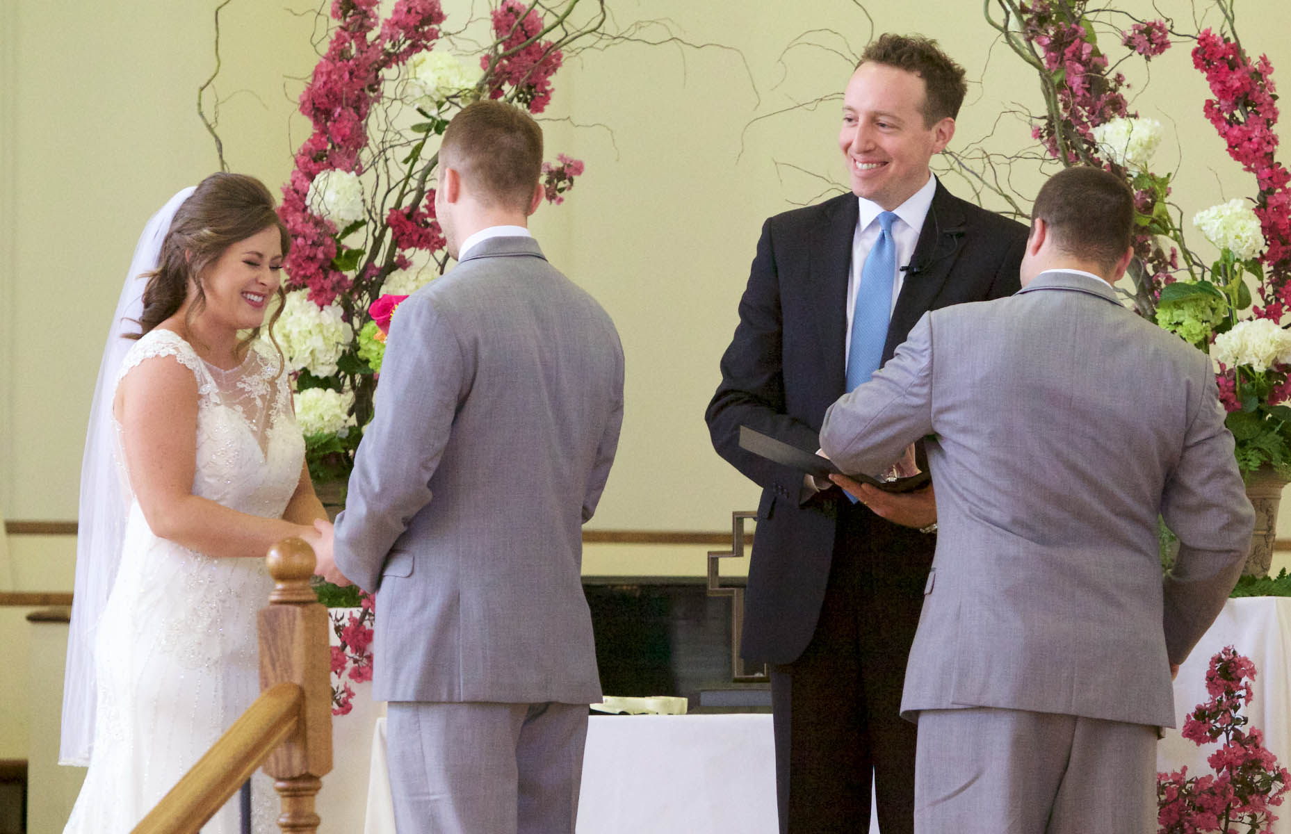 Alissa laughs as the best man hands officiant Tim Chipman a  ring pop. Wedding pictures by Tiffany & Steve of Warmowski Photography.
