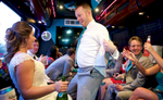 Ben has fun with Alissa on the party bus. Wedding pictures by Tiffany & Steve of Warmowski Photography.