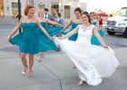 Alissa and her bridesmaids have fun with their flowy dresses. Wedding pictures by Tiffany & Steve of Warmowski Photography.