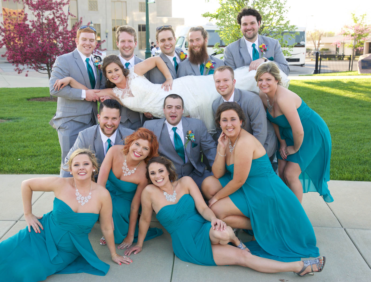 The wedding party tries a pose, outdoor portaits in downtown Jacksonville. Wedding pictures by Tiffany & Steve of Warmowski Photography.