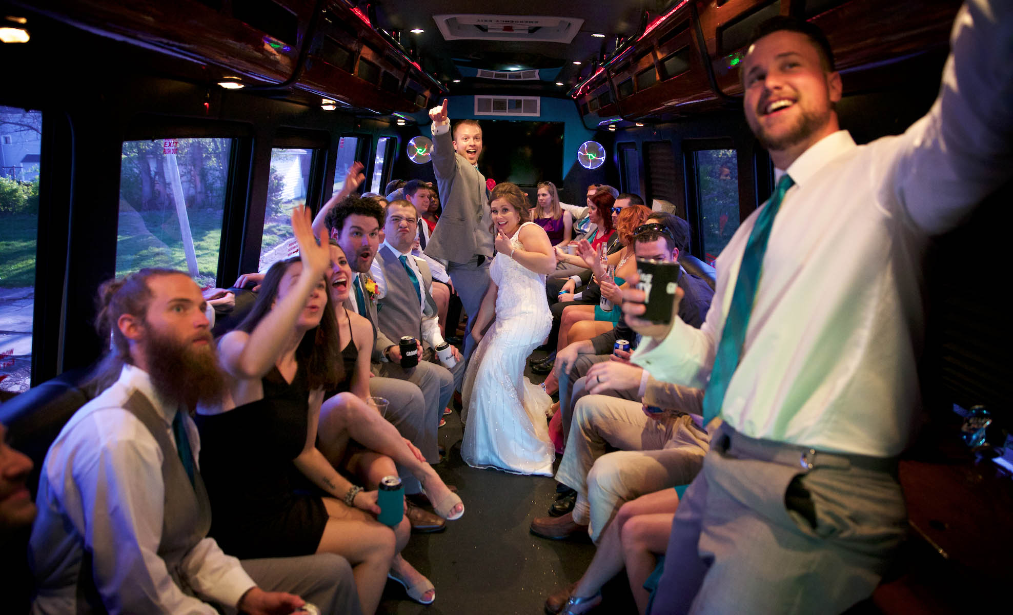 Back on the party bus for the final leg to Hamilton's 110 North East. Wedding pictures by Tiffany & Steve of Warmowski Photography.