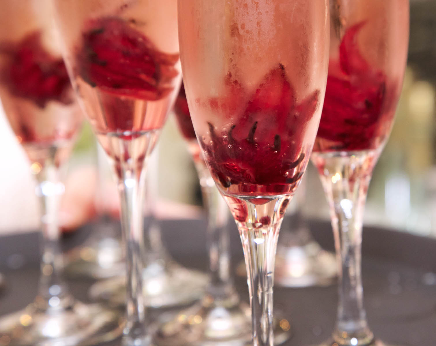 Champagne flutes with flowers. Wedding pictures by Tiffany & Steve of Warmowski Photography.