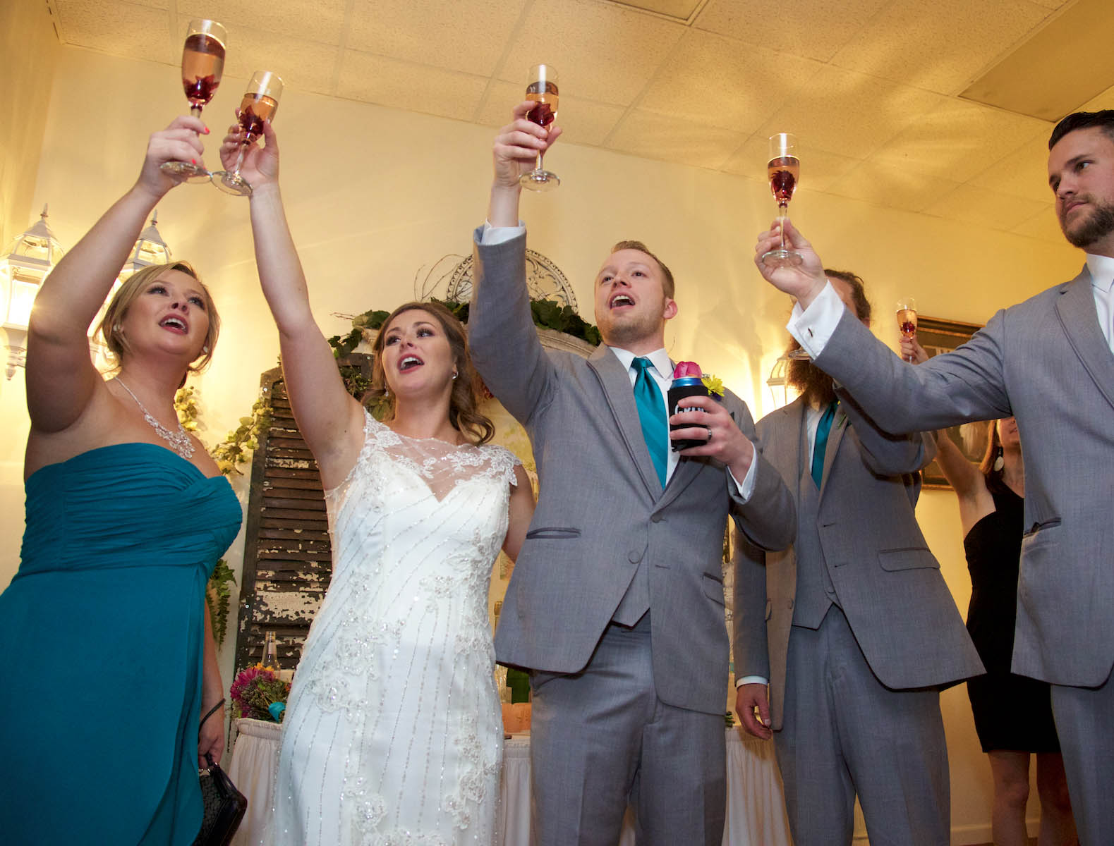Toasting in the VIP room at Hamilton's 110 North East. Wedding pictures by Tiffany & Steve of Warmowski Photography.
