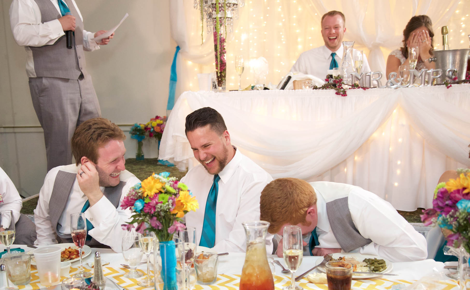 Sam gets laughs during his Best Man toast. Wedding pictures by Tiffany & Steve of Warmowski Photography.