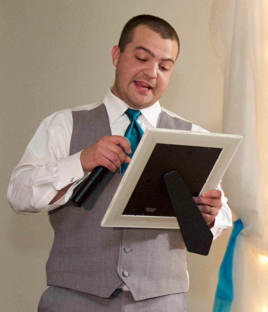 Best Man Sam reads a childhood letter to his brother. Wedding pictures by Tiffany & Steve of Warmowski Photography.