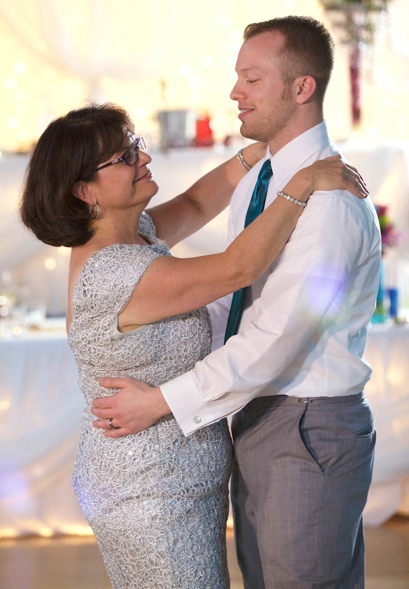 Ben with his mother during first dances. Wedding pictures by Tiffany & Steve of Warmowski Photography.