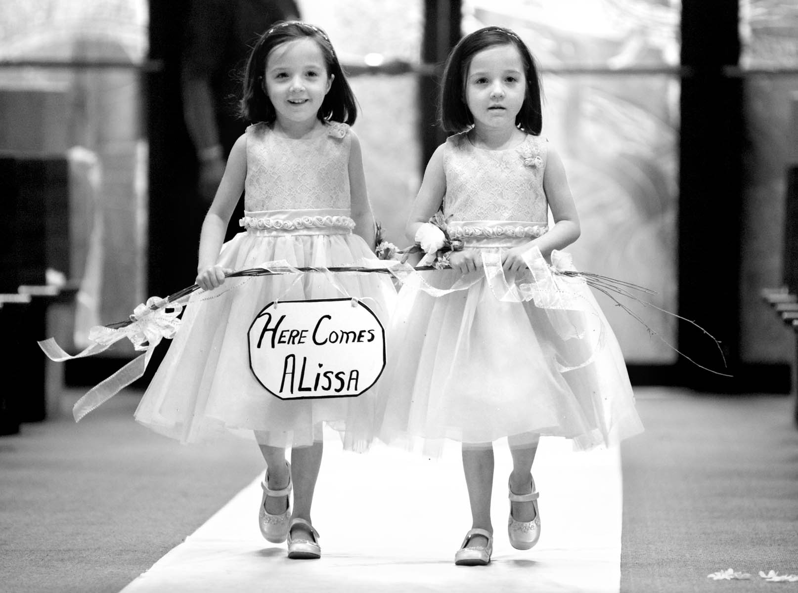 Flower girls, wedding of Alissa & Brandon at Our Saviour Catholic Church, Jacksonville. Wedding photography by Tiffany & Steve Warmowski.