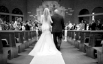 Alissa comes down the aisle, Our Saviour Catholic Church, Jacksonville. Wedding photography by Tiffany & Steve Warmowski.