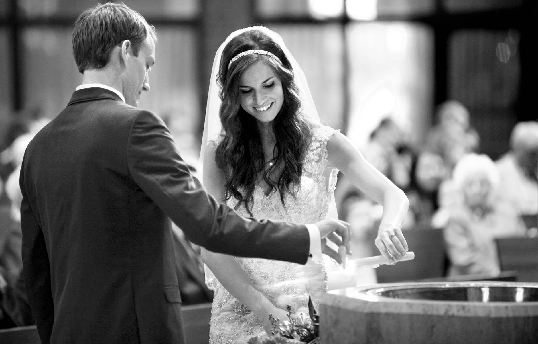 Unity candle, Alissa & Brandon ceremony at Our Saviour Catholic Church, Jacksonville. Wedding photography by Tiffany & Steve Warmowski.