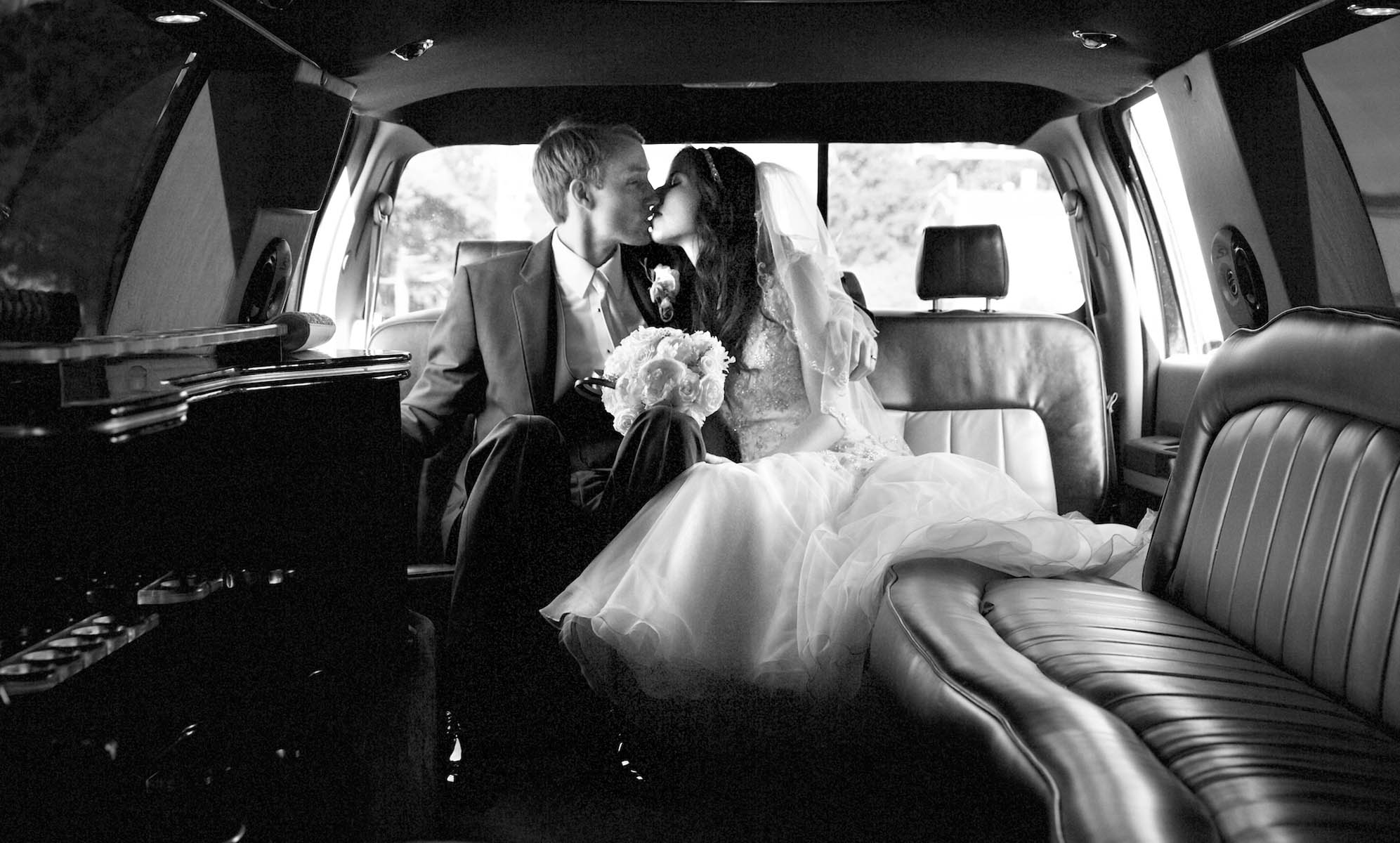Private moment in the limousine, Alissa & Brandon's wedding at Our Saviour Catholic Church, Jacksonville. Wedding photography by Tiffany & Steve Warmowski.