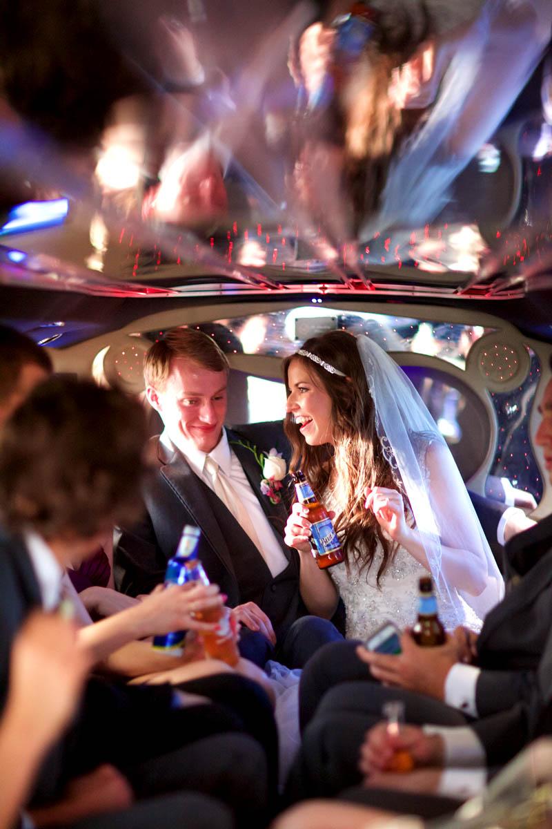 Limousine ride to reception at Hamilton's 110 North East, Alissa & Brandon's wedding in Jacksonville. Wedding photography by Tiffany & Steve Warmowski.