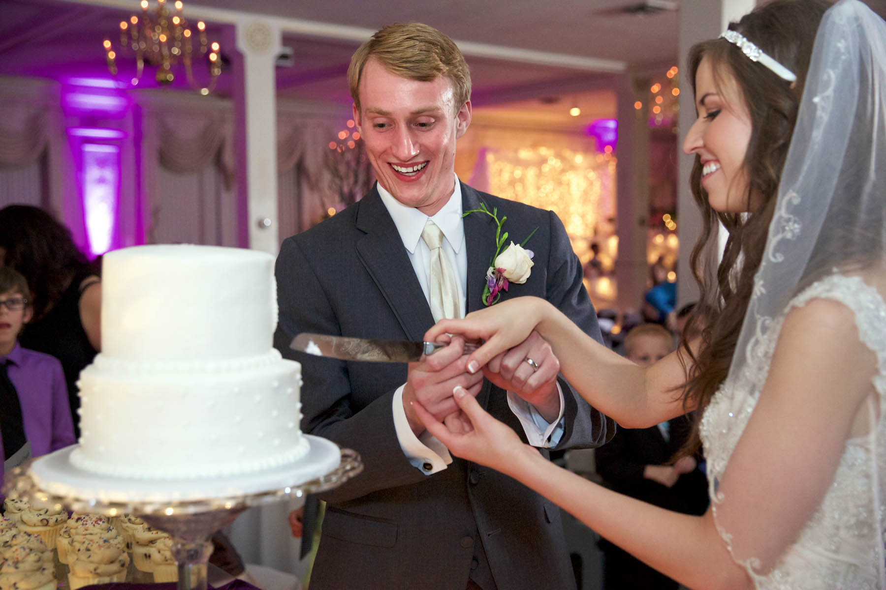 Cake cutting, Alissa & Brandon's wedding reception at Hamilton's 110 North East. Wedding photography by Tiffany & Steve Warmowski.