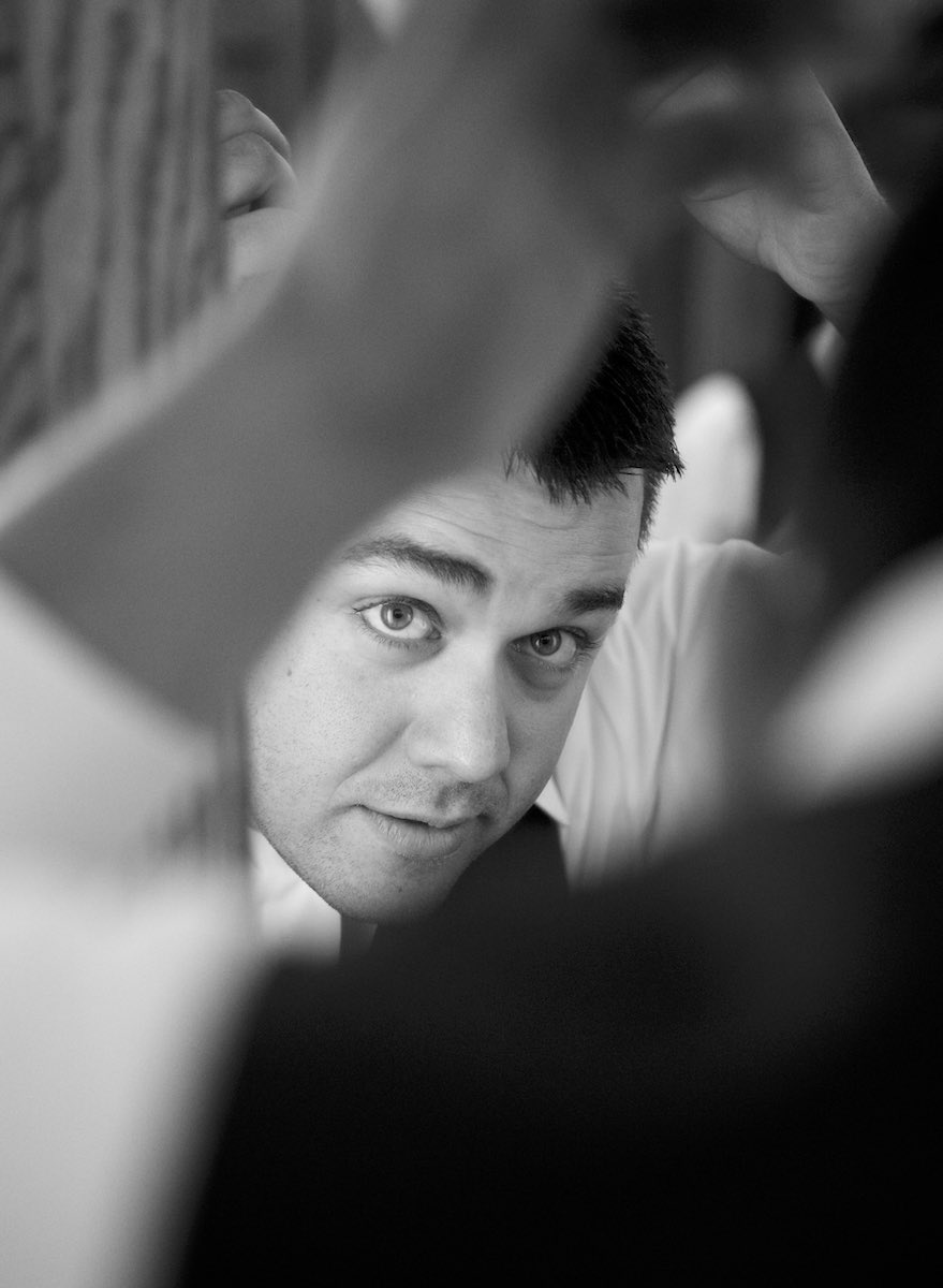 Nick gets ready at the Jacksonville Illinois Country Club. Wedding photography by Steve & Tiffany Warmowski.