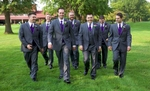 Nick walks with his groomsmen and ushers to the outdoor wedding ceremony site at the Jacksonville Country Club. Sometimes when the groomsmen want to do a cool group photo we have them walk Reservoir Dogs-esque, but this crew did this all naturally. Wedding photography by Steve & Tiffany Warmowski.