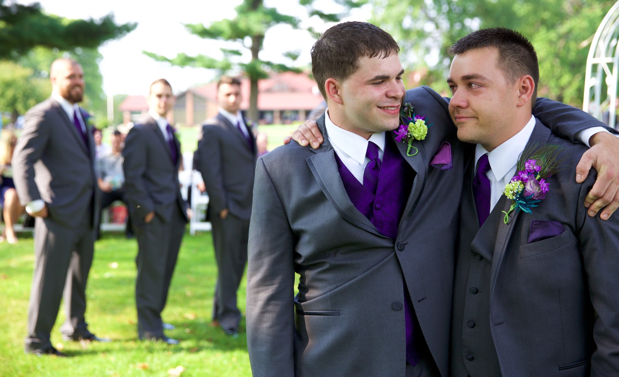 Best Man Clay hugs Nick after getting emotional before the wedding ceremony at the Jacksonville Illinois Country Club. Wedding photography by Steve & Tiffany Warmowski.