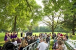 Outdoor wedding ceremony beneath the trees at the Jacksonville Illinois Country Club. Wedding photography by Steve & Tiffany Warmowski.