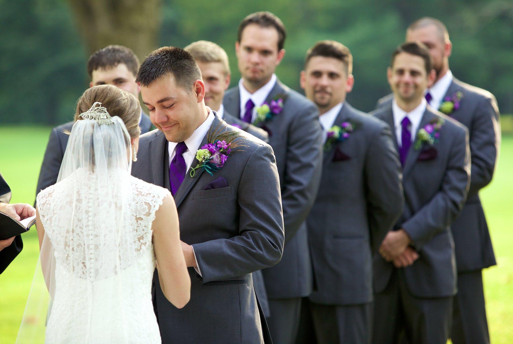 Amanda & Nick exchange rings, wedding ceremony at the Jacksonville Illinois Country Club. Wedding photography by Steve & Tiffany Warmowski.