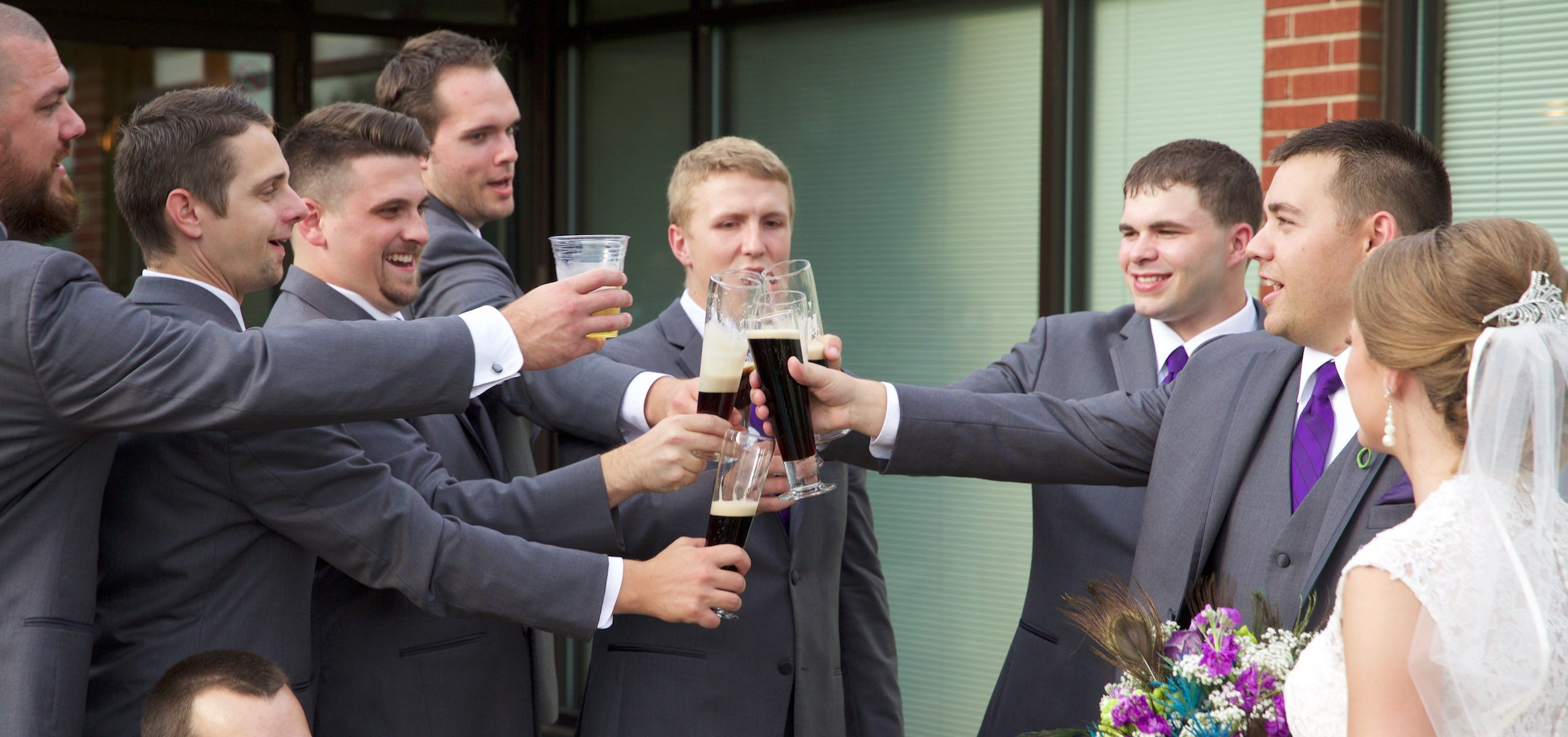 Groomsmen toast as Amanda & Nick walk back to the Jacksonville Illinois Country Club for their wedding reception. Wedding photography by Steve & Tiffany Warmowski.