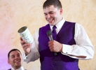 Best Man Clay brings out a {quote}can of common sense{quote} Nick gave to him back in high school during toasts, wedding reception at the Jacksonville Illinois Country Club. Wedding photography by Steve & Tiffany Warmowski.
