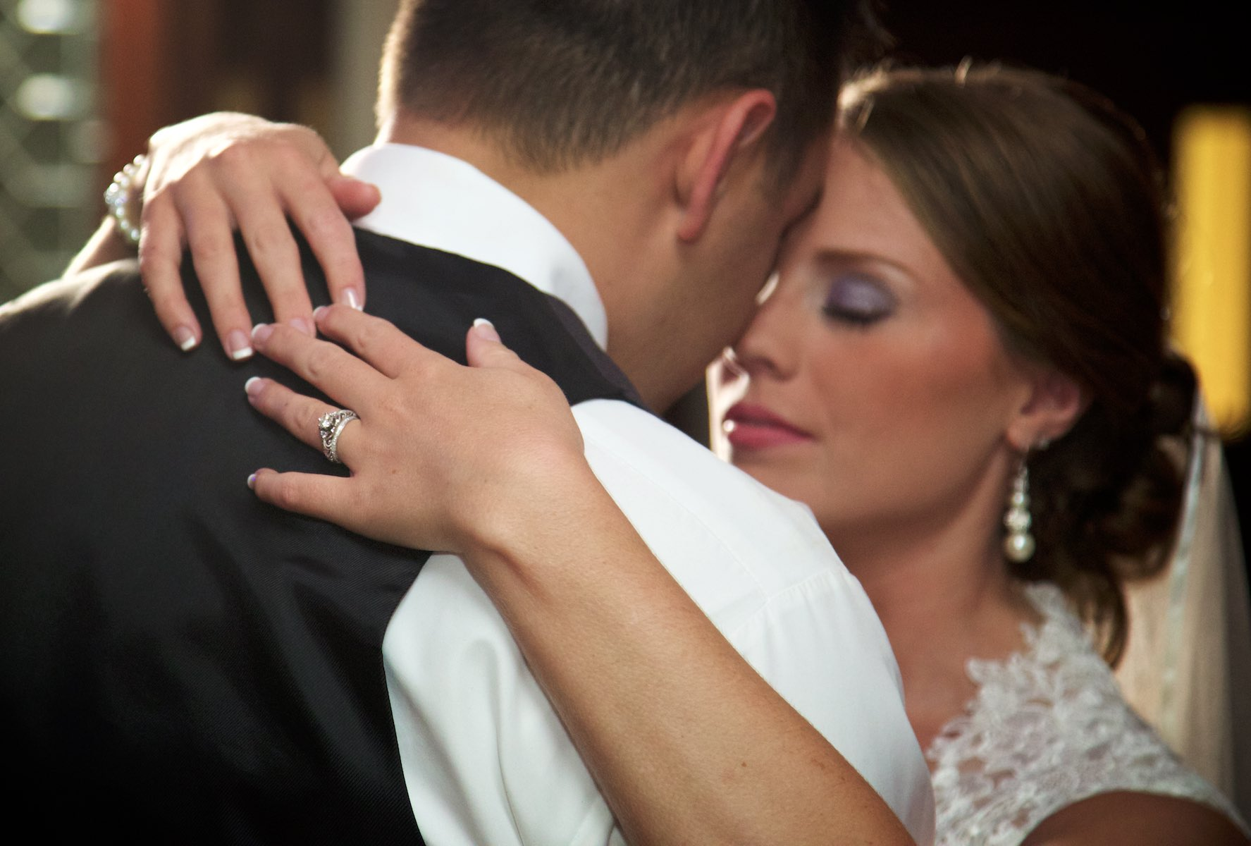 First dance, Amanda & Nick's wedding reception at the Jacksonville Illinois Country Club. Wedding photography by Steve & Tiffany Warmowski.