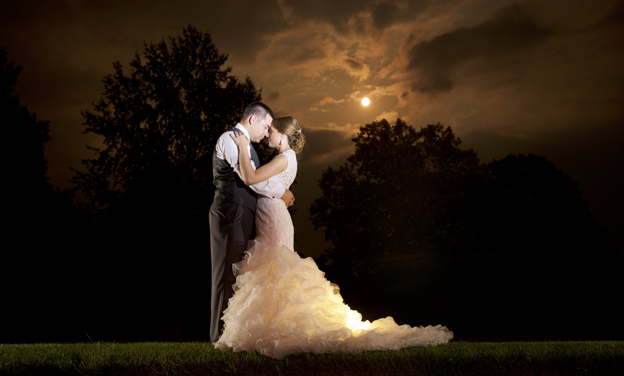 Portrait by moonlight, Amanda & Nick's wedding at the Jacksonville Illinois Country Club. Wedding photography by Steve & Tiffany Warmowski.