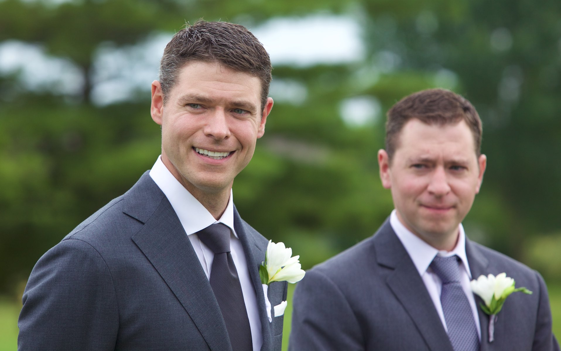 Groom with his best man (and twin brother), wedding of Emi & Daniel at Geneva National Golf Club in Lake Geneva, Wisconsin. Wedding photography by Steve & Tiffany Warmowski.