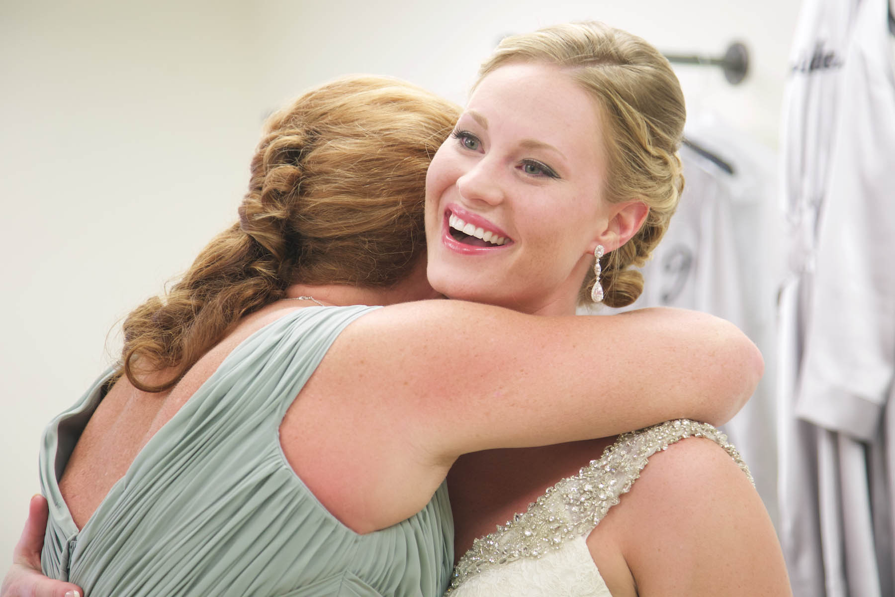 Jaclyn hugs her mother before the ceremony at Allerton Park, Monticello. Wedding photography by Tiffany & Steve of Warmowski Photography.
