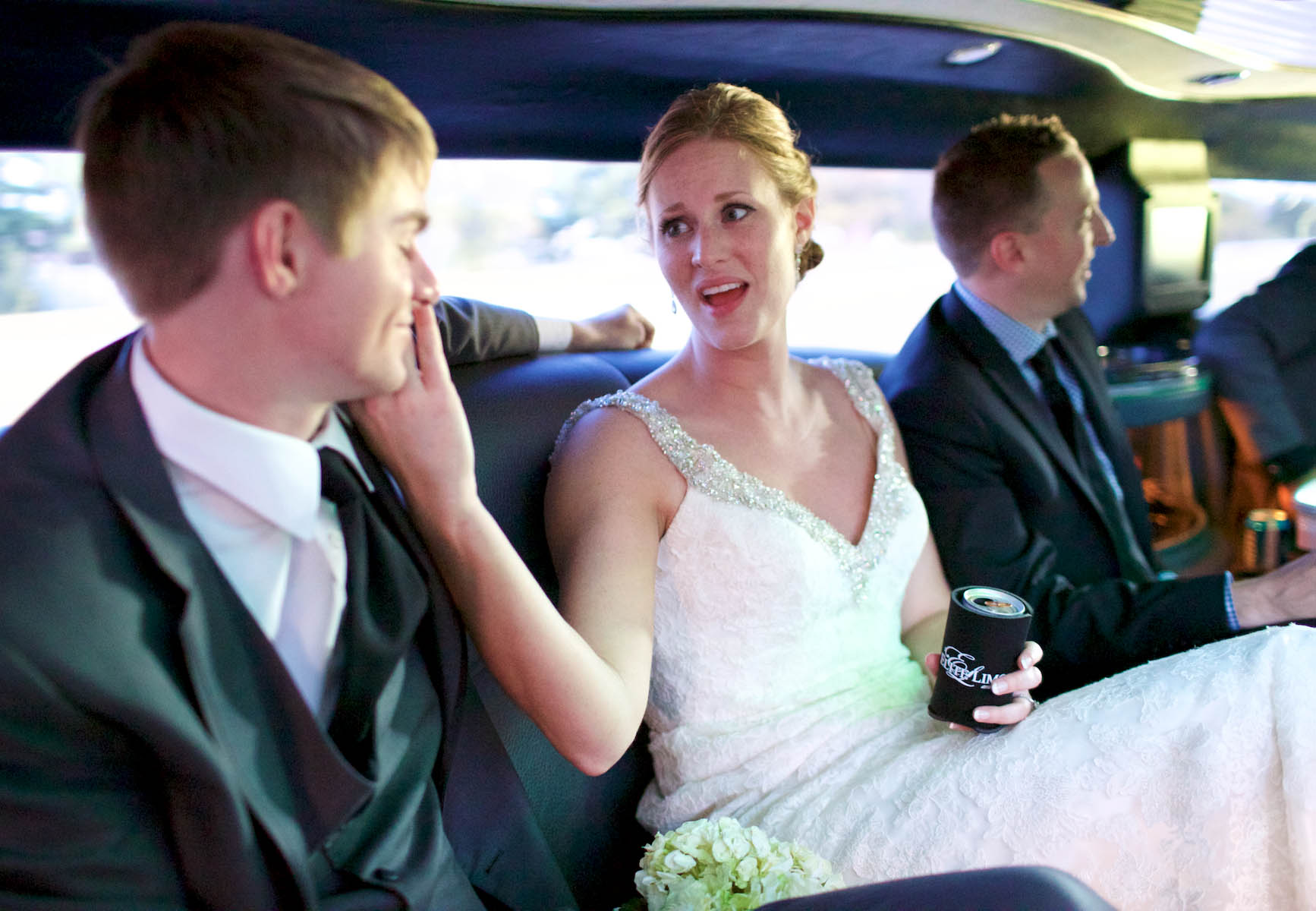 Jaclyn sings to Scott as the wedding party enjoys the limousine on the trip to the iHotel in Champaign for the wedding reception. Wedding photography by Tiffany & Steve of Warmowski Photography.