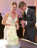 Jaclyn & Scott cut the cake, wedding reception at iHotel, Champaign. Wedding photography by Tiffany & Steve of Warmowski Photography.