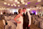 End-of-the-night portrait showing decorations in the iHotel ballroom. Wedding photography by Tiffany & Steve of Warmowski Photography.