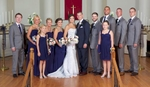 Jeremy and Adria with bridal party, portraits around MacMurray College's Annie Merner Chapel before the ceremony, Jacksonville, Illinois. Wedding photography by Steve & Tiffany Warmowski.