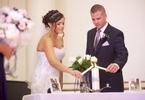 Adria and Jeremy light unity candle, wedding ceremony at Annie Merner Chapel, MacMurray College, Jacksonville, Illinois. Wedding photography by Steve & Tiffany Warmowski.