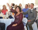 Family and friends raise their glasses for toast, wedding reception at Hamilton's 110 North East, Jacksonville, Illinois. Wedding photography by Steve & Tiffany Warmowski.
