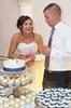Adria & Jeremy cut their wedding cake, wedding reception at Hamilton's 110 North East, Jacksonville, Illinois. Wedding photography by Steve & Tiffany Warmowski.