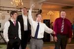 Catching the garter, wedding reception at Hamilton's 110 North East, Jacksonville, Illinois. Wedding photography by Steve & Tiffany Warmowski.