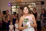 Bouquet toss, wedding reception at Hamilton's 110 North East, Jacksonville, Illinois. Wedding photography by Steve & Tiffany Warmowski.