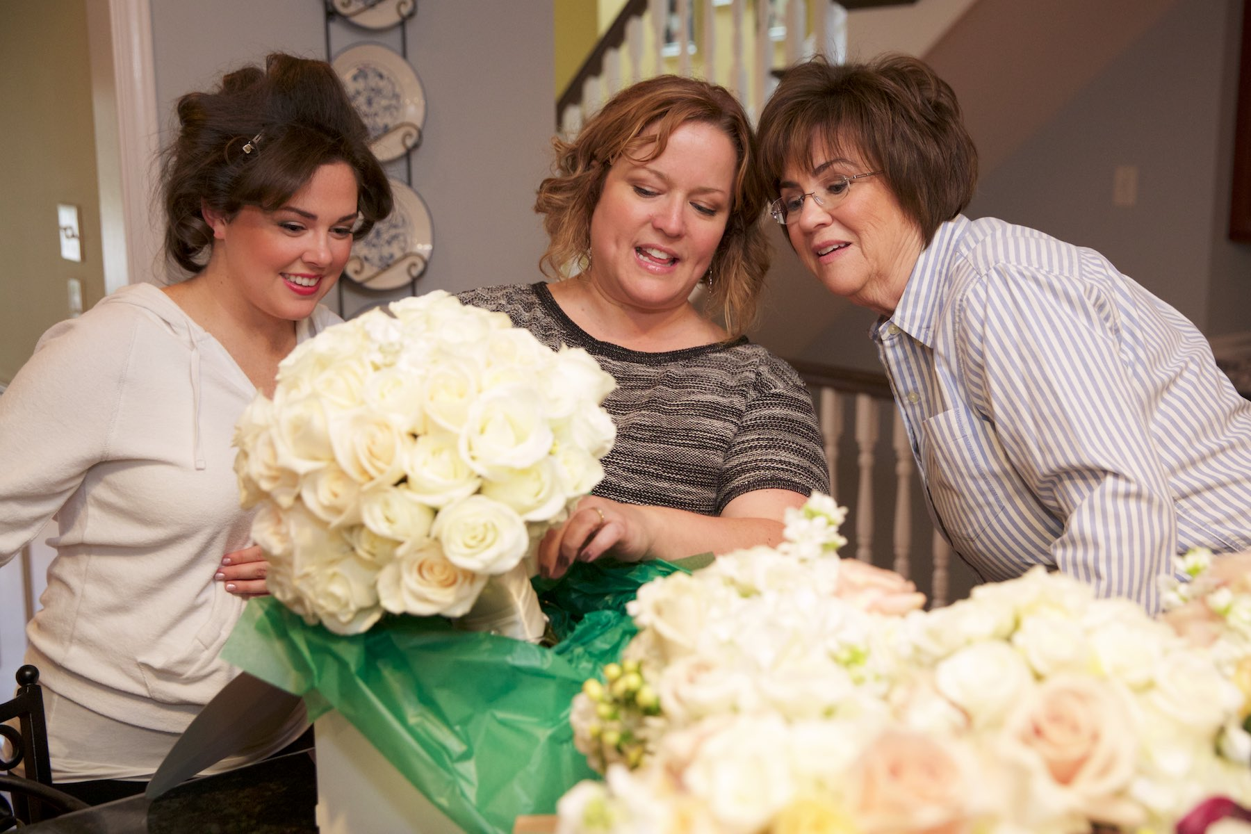 Elizabeth and her mother check out bouquets with Sass & Class Flowers florist at their home. Wedding photography by Steve & Tiffany Warmowski