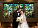 Elizabeth & Daniel wedding portraits, featuring the stained glass windows at St. Rita of Cascia Shrine Chapel in Chicago. Wedding photography by Steve & Tiffany Warmowski